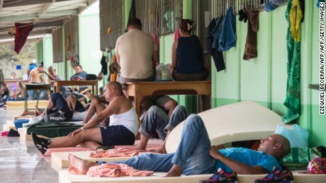 Part of a group of 300 Cubans who remain in a shelter rest, in La Cruz, Guanacaste, Costa Rica, near the border with Nicaragua on November 26, 2015. Latin American ministers failed in two rounds of meetings Tuesday to find a solution for thousands of US-bound Cuban migrants stranded in Costa Rica, the foreign minister of that country said.   AFP PHOTO/Ezequiel BECERRA / AFP / EZEQUIEL BECERRA        (Photo credit should read EZEQUIEL BECERRA/AFP/Getty Images)