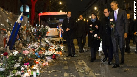 President Barack Obama, French President Francois Hollande, second from right, and Paris Mayor Anne Hidalgo arrive at the Bataclan, site of one of the Paris terrorists attacks, to pay their respects to the victims, after Obama arrived in town for the COP21 climate change conference, on Monday, Nov. 30, 2015, in Paris. (AP Photo/Evan Vucci