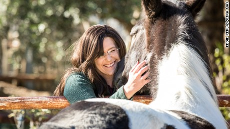 Shelly May interacts with a horse at the Ortega Equestrian Center.