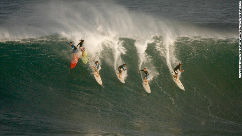 Surfers ride a wave before the Eddie Aikau Big-Wave Invitational in 2009, the last time the contest was held.