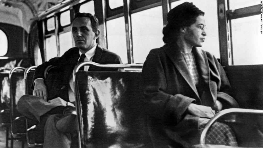 "Rosa Parks <a href=""http://www.cnn.com/2010/US/12/01/rosa.parks.anniversary/index.html"">became one of the major symbols of the modern civil rights movement</a> when she was arrested in Montgomery, Alabama, on December 1, 1955, after refusing to give up her seat in the black section of a city bus to a white passenger. For 381 days, African-Americans boycotted public transportation to protest Parks' arrest and, in turn, segregation laws. The boycott led to a U.S. Supreme Court ruling desegregating public transportation in Montgomery and catapulted its organizer, the Rev. Martin Luther King Jr., to the forefront of the civil rights movement. Pictured here, Parks rides the bus in 1956, a day after the Supreme Court ruling."