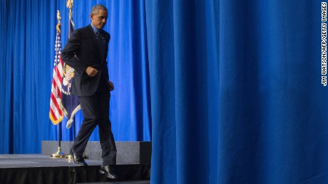 US President Barack Obama leaves after a speech during press conference at the Organization for Economic Co-Operation and Development Centre in Paris on December 1, 2015.