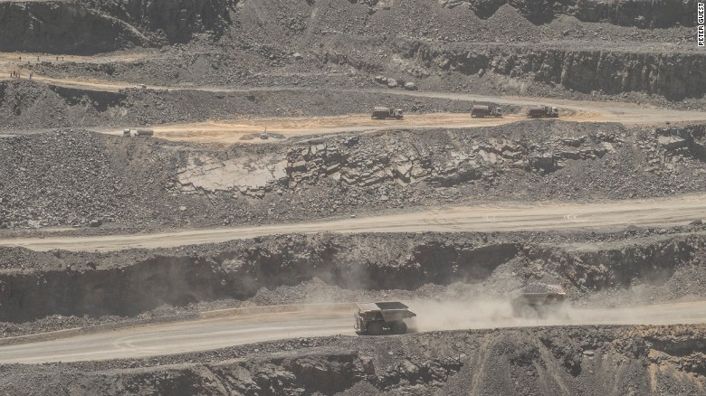 Trucks cross in the main pit of the Jwaneng diamond mine in Botswana, November 2015