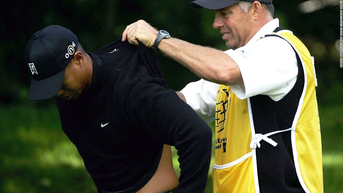 The 14-time major winner has a long history of injury problems. Here he has cream rubbed into his back by former caddy Steve Williams during the 2004 American Express Championship.