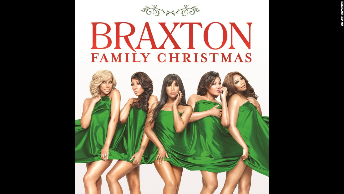 'For the first time in 25 years, Toni Braxton reunites with all four of her sisters -- Tamar, Towanda, Trina and Traci -- for an official Braxton Family Christmas album.' from the web at 'http://i2.cdn.turner.com/cnnnext/dam/assets/151202123629-02-christmas-albums-2015-super-169.jpg'