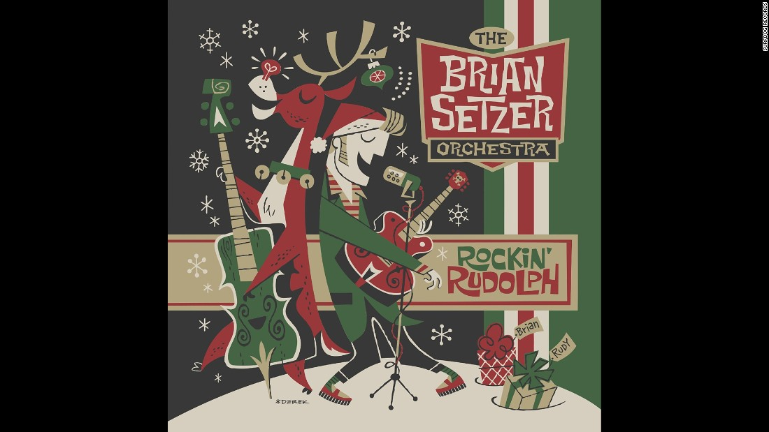 """'You thought the swing revival ended in the '90s? No! The former Stray Cat is back with such kickin' tunes as """"Rockin' Around the Christmas Tree"""" and """"Yabba-Dabba Yuletide"""" from """"The Flintstones.""""' from the web at 'http://i2.cdn.turner.com/cnnnext/dam/assets/151202124009-05-christmas-albums-2015-super-169.jpg'"""