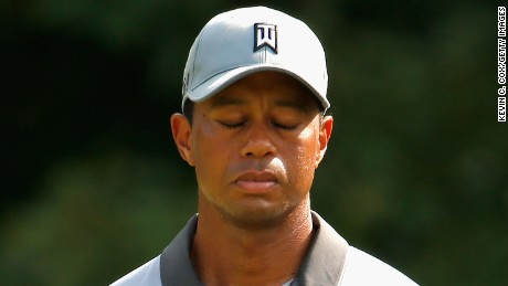 GREENSBORO, NC - AUGUST 22:  Tiger Woods reacts after missing his birdie putt on the 13th green during the third round of the Wyndham Championship at Sedgefield Country Club on August 22, 2015 in Greensboro, North Carolina.  (Photo by Kevin C. Cox/Getty Images)
