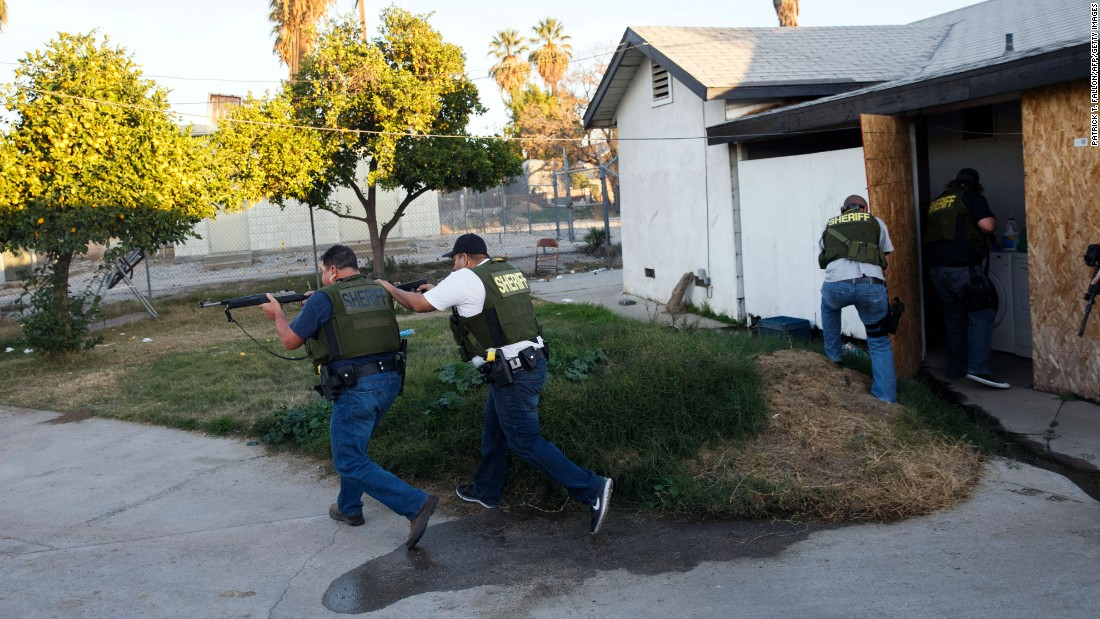 "Law enforcement officers search for the suspects of <a href=""http://www.cnn.com/2015/12/02/us/gallery/san-bernardino-shooting/index.html"" target=""_blank"">a mass shooting in San Bernardino</a>, California, on Wednesday, December 2. Earlier in the day, at least 14 people were killed and 17 were injured at the Inland Regional Center, where employees with the county health department were attending a holiday event. Two suspects were fatally shot in a gun battle with police hours after the initial incident."