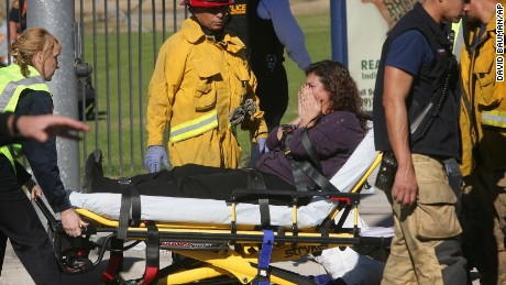 A victim is wheeled away on a stretcher following a shooting that killed multiple people at a social services facility, Wednesday, Dec. 2, 2015, in San Bernardino, Calif. (David Bauman/The Press-Enterprise via AP)  MAGS OUT; MANDATORY CREDIT; LOS ANGELES TIMES OUT