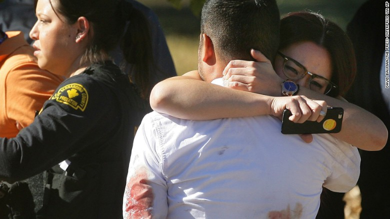 A couple embraces following a shooting that killed multiple people at a social services facility, Wednesday, Dec. 2, 2015, in San Bernardino, Calif. (David Bauman/The Press-Enterprise via AP) MAGS OUT; MANDATORY CREDIT; LOS ANGELES TIMES OUT