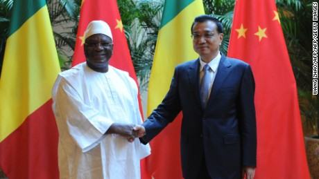 Malian President Ibrahim Boubacar Keita (L) shakes hands with Chinese Premiere Li Keqiang (R) during the World Economic Forum in Tianjin in 2014.  China has recently pledged to assist security operations in Mali, following an Islamist attack on a hotel in the capital Bamako in Novermber 2015.  Three Chinese nationals, who worked for the state run China Railway Construction Corp, were killed.