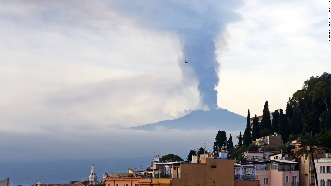 Smoke rises over the Italian city of Taormina during an eruption of Mount Etna, one of the most active volcanoes in the world, on December 4.
