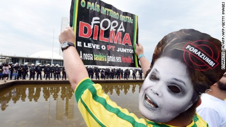 Protesters demonstrate calling for the impeachment of Brazilian president Dilma Rousseff and blaming her for a steep economic downturn in Brazil, in Brasilia on November 15, 2015.  AFP PHOTO / EVARISTO SA        (Photo credit should read EVARISTO SA/AFP/Getty Images)