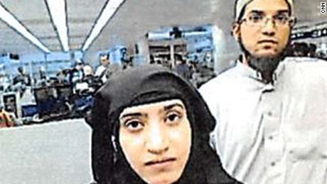 Tashfeen Malik and Syed Rizwan Farook were photographed at Chicago's O'Hare International Airport in 2014.