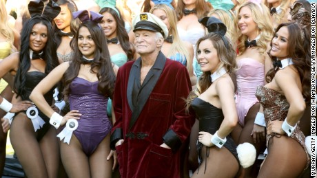 LOS ANGELES, CA - JANUARY 16:  Hugh Hefner poses with Playboy Bunnies at Playboy's 60th Anniversary special event on January 16, 2014 in Los Angeles, California.  (Photo by Rachel Murray/Getty Images for Playboy)