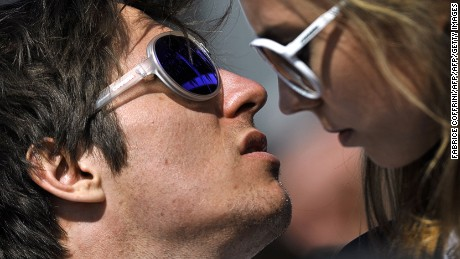 Overall World Cup winner Austria's Marcel Hirscher (L) looks on next to his girlfriend Laura (R) at the FIS Alpine Skiing World Cup finals in Schladming on March 18, 2012.  AFP PHOTO / FABRICE COFFRINI (Photo credit should read FABRICE COFFRINI/AFP/Getty Images)