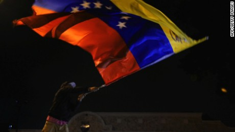 Venezuelan opposition supporters celebrate the results of the legislative election in Caracas, on the early morning December 7, 2015. Venezuela's opposition won --at least--a majority of 99 out of 167 seats in the state legislature, electoral authorities said Monday, the first such shift in power in congress in 16 years. AFP PHOTO/LUIS ROBAYOLUIS ROBAYO/AFP/Getty Images