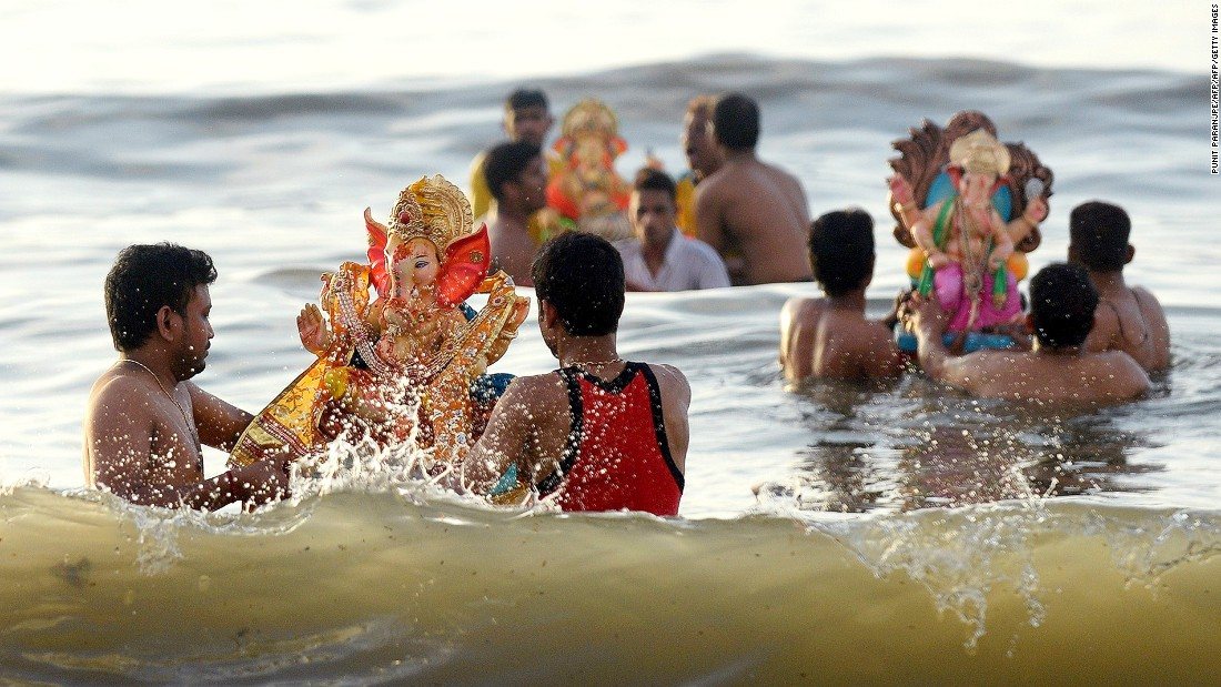 Chowpatty, a stretch of sand in Mumbai, hosts the annual festival of Ganesh. Indian Hindu devotees carry idols of elephant-headed Hindu god Ganesha and immerse them in the sea at the end of the 10-day festival as a part of a cleansing ritual.