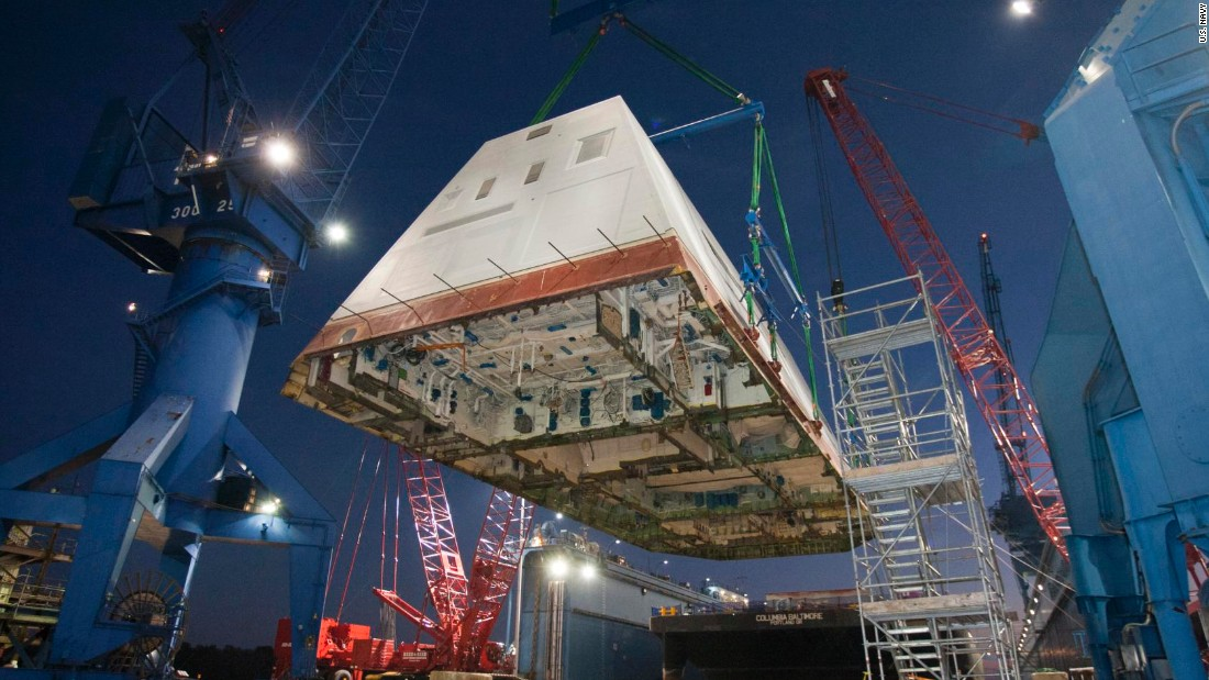 The 1,000-ton deckhouse is craned toward the deck of the ship to be integrated with the its hull at Bath Iron Works on December 14, 2012.