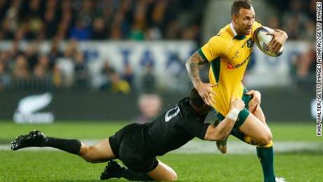 AUCKLAND, NEW ZEALAND - AUGUST 15:  Quade Cooper of the Wallabies is tackled by Dan Carter of the All Blacks during The Rugby Championship, Bledisloe Cup match between the New Zealand All Blacks and the Australian Wallabies at Eden Park on August 15, 2015 in Auckland, New Zealand.  (Photo by Phil Walter/Getty Images)