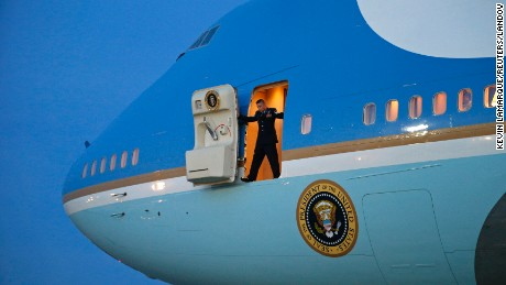 Image #: 34133890    A crew member stands in the door of Air Force One waiting for the passenger stairs, upon the arrival of U.S. President Barack Obama at Joint Base Andrews in Washington January 8, 2015. Obama returned from a two-day trip to Michigan and Arizona.   REUTERS/Kevin Lamarque  (UNITED STATES - Tags: POLITICS TRANSPORT TPX IMAGES OF THE DAY)       REUTERS /KEVIN LAMARQUE /LANDOV