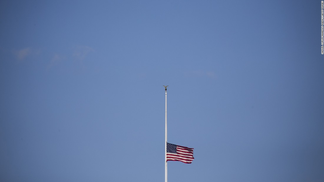 The American flag flies at half-staff above the White House on ...