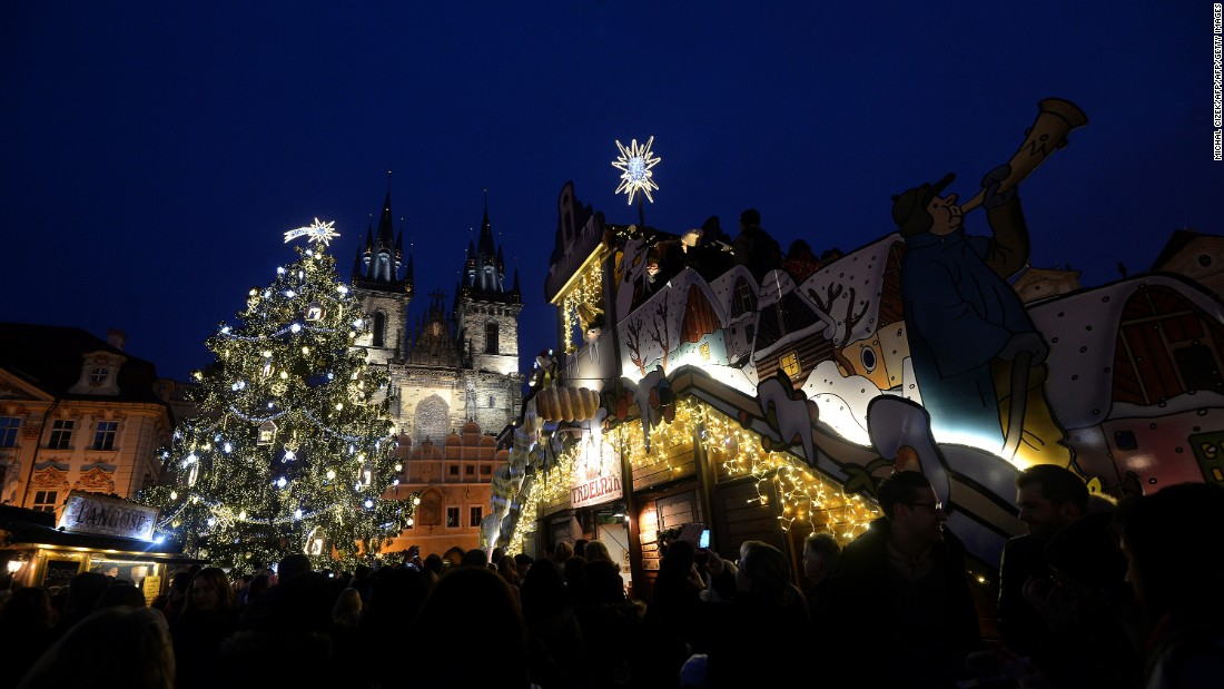 An illuminated tree lights the market at the Old Town Square in Prague.