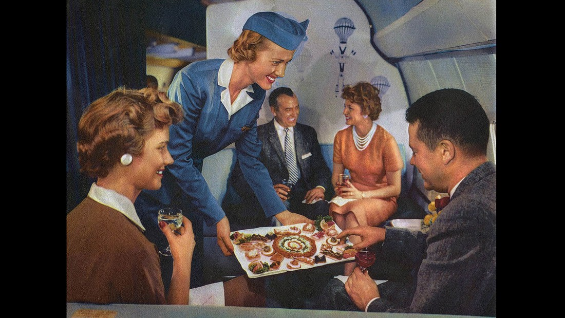 """In-flight canapes were regularly offered to the """"pearl set."""" Uh-oh, it's the guy in the bow tie again. Let's hope he didn't take as long to choose his food as he did to make a chess move."""