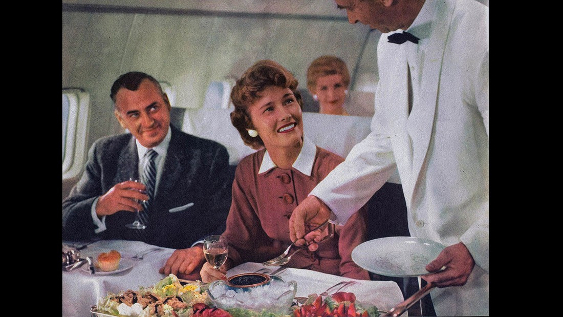 Dinner for adults came with white linen table cloths and full waiter service. Caviar, salad nicoise and a charcuterie platter for her. Cupcake for him.
