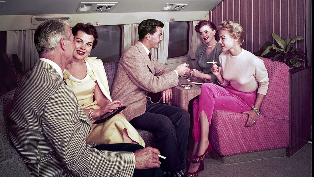 This shot shows life on board a Douglas DC-7, a plane popular before passenger jets took over. The only thing smooth aboard this 1950s piston-powered aircraft was the guy with a tweed jacket and light for the ladies.