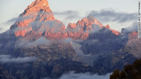 The morning sun hits the tips of the Grand Tetons on October 5, 2012 in the Grand Teton National Park in Wyoming.