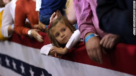 AVON LAKE, OH - OCTOBER 29: A young girls looks on during a campaign rally for Republican presidential candidate, former Massachusetts Gov. Mitt Romney at Avon Lake High School on October 29, 2012 in Avon Lake, Ohio. Romney has canceled other campaign events on October 29 and 30 due to Hurrcane Sandy.  (Photo by Justin Sullivan/Getty Images)