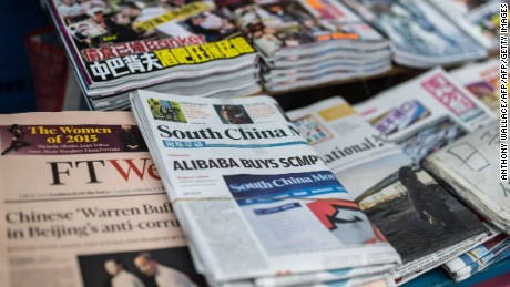 A copy (C) of the South China Morning Post (SCMP) is displayed at a newsstand in Hong Kong on December 12, 2015, following its acquisition by Chinese internet giant Alibaba of the English-language newspaper. Alibaba said on December 11 it would buy Hong Kong's South China Morning Post, pledging to maintain the newspaper's objectivity in the face of fears it will lose its independent voice.   AFP PHOTO / ANTHONY WALLACEANTHONY WALLACE/AFP/Getty Images