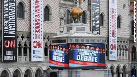 Signs outside the Venetian hotel on the Las Vegas Strip announce the upcoming Republican presidential debate, hosted by CNN, December 14, 2015,  in  Las Vegas, Nevada.  On the main stage for the December 15 GOP debate, the fifth of the primary season, will be businessman Donald Trump, Texas Sen. Ted Cruz, retired neurosurgeon Ben Carson, Florida Sen. Marco Rubio, former Florida Gov. Jeb Bush, businesswoman Carly Fiorina, Ohio Gov. John Kasich, New Jersey Gov. Chris Christie, and Kentucky Sen. Rand Paul.  AFP PHOTO / ROBYN BECK / AFP / ROBYN BECK        (Photo credit should read ROBYN BECK/AFP/Getty Images)