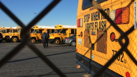 Los Angeles Unified School District buses stand idle in Gardena, Calif., on Tuesday, Dec. 15, 2015.  All Los Angeles area public schools were shut down Tuesday after a after a school board member received an emailed threat that raised fears of another attack like the deadly shooting in nearby San Bernardino. (AP Photo/Damian Dovarganes)