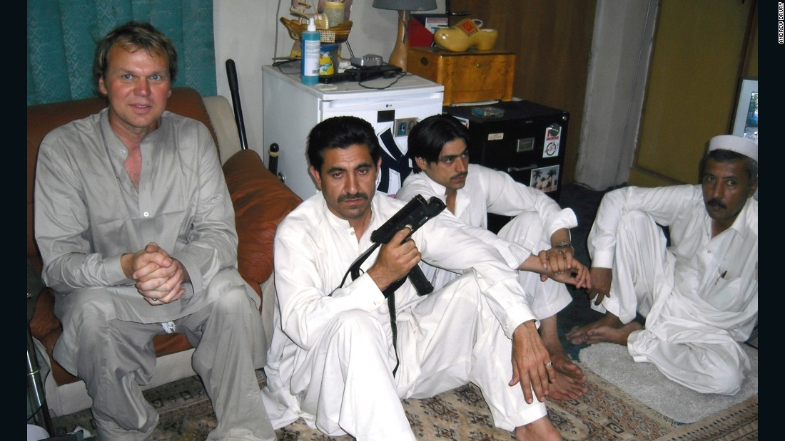 2009: A chance encounter with a forger in Kandahar, Afghanistan, led to a smuggler's bazaar. Drury is pictured here with some of the traders.