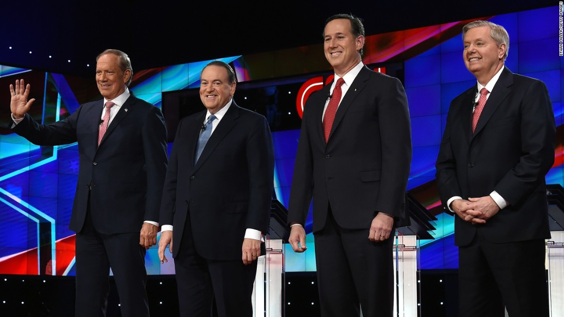 "Four Republican presidential candidates take the stage for the ""undercard"" debate featuring lower-polling candidates. From left are former New York Gov. George Pataki, former Arkansas Gov. Mike Huckabee, former U.S. Sen. Rick Santorum and U.S. Sen. Lindsey Graham."
