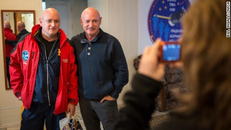 Expedition 43 NASA Astronaut Scott Kelly, left, and his identical twin brother Mark Kelly, pose for a photograph Thursday, March 26, 2015 at the Cosmonaut Hotel in Baikonur, Kazakhstan. Scott Kelly, and Russian Cosmonauts Mikhail Kornienko, and Gennady Padalka of the Russian Federal Space Agency (Roscosmos) are scheduled to launch to the International Space Station in the Soyuz TMA-16M spacecraft from the Baikonur Cosmodrome in Kazakhstan March 28, Kazakh time (March 27 Eastern time.) As the one-year crew, Kelly and Kornienko will return to Earth on Soyuz TMA-18M in March 2016.  Photo Credit (NASA/Bill Ingalls)