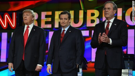 Republican presidential candidates Donald Trump, Sen. Ted Cruz and Jeb Bush stand on stage during the CNN presidential debate at The Venetian Las Vegas on December 15, 2015.