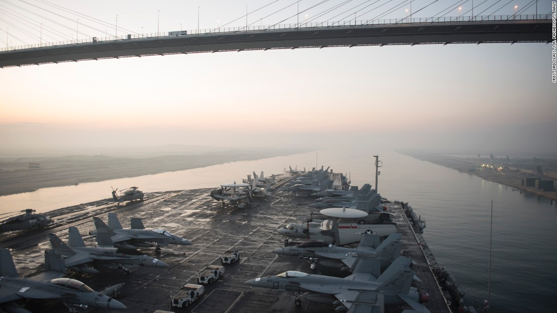 The aircraft carrier USS Harry S. Truman (CVN 75) passes under the Friendship Bridge while transiting the Suez Canal on Dec. 14, 2015. The ship is conducting operations in the Persian Gulf, where Iran claims to have taken footage of the carrier using a drone. Click through the gallery for more images of U.S. Navy aircraft carriers.