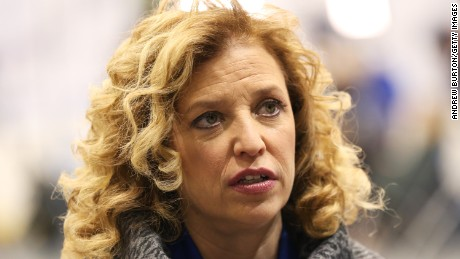 U.S. Representative Debbie Wasserman Schultz (D-FL 23rd District) and chair of the Democratic National Committee (DNC) speaks to a reporter before the democratic debate on December 19, 2015 in Manchester, New Hampshire. The DNC has been criticized for the timing of democratic debates during the 2016 presidential race.
