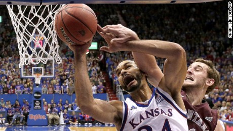 Montana's Jack Lopez fouls Kansas' Perry Ellis (34) as he puts up a shot during the first half of an NCAA college basketball game Saturday, Dec. 19, 2015, in Lawrence, Kan. (AP Photo/Charlie Riedel)