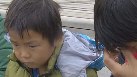 Hong Laibao, 6, awaits news about his parents