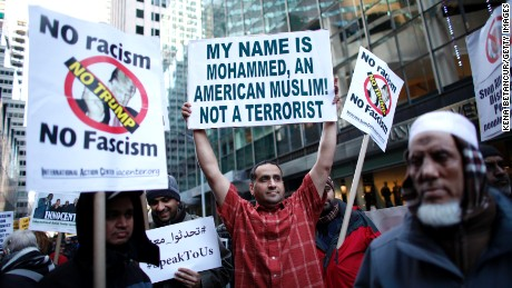 A group of Muslim Americans take part in a rally in front of Trump Tower December 20, 2015 in New York City. Trump proposed a call for a ban on Muslims entering the United States.