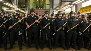 Police queue up at the Minneapolis-St. Paul International airport lightrail stop, where a number of Black Lives Matter protestors attempted to enter the airport.