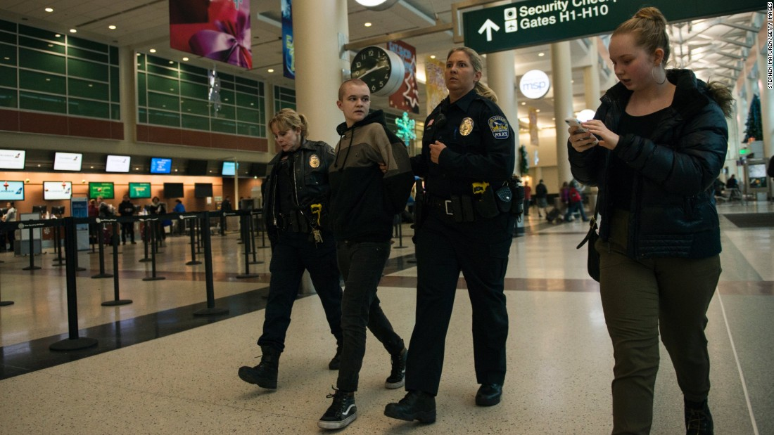 A woman is arrested at the Black Lives Matter protest at the airport Wednesday.