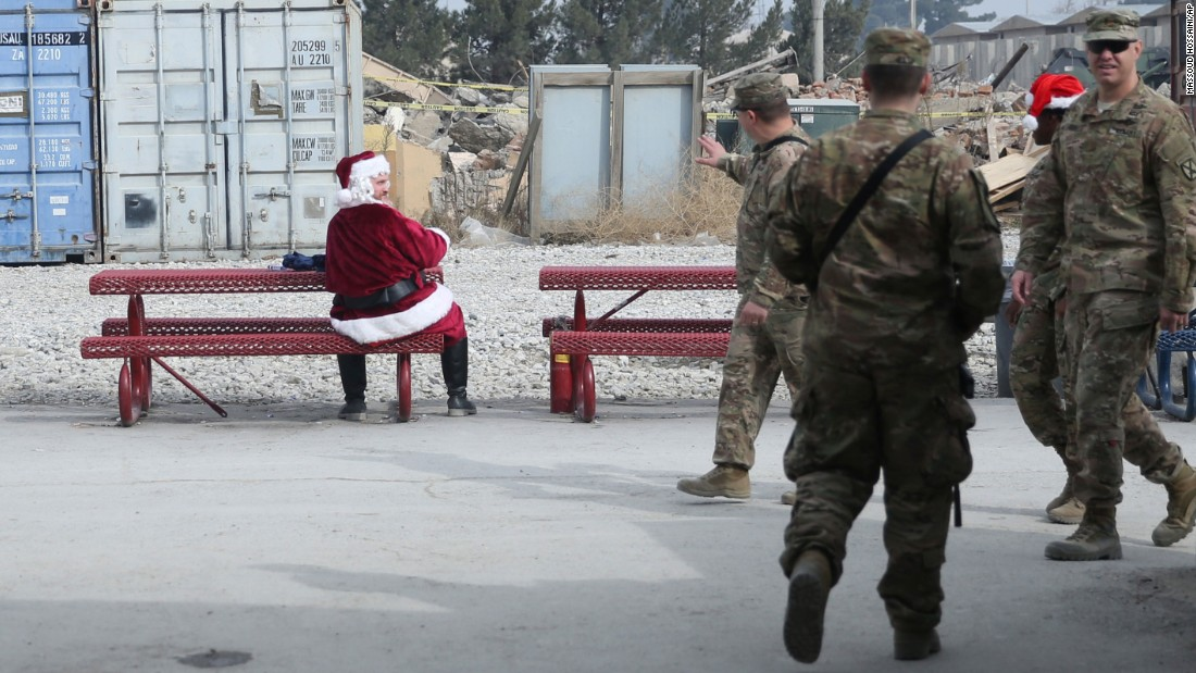 A U.S. soldier dressed as Santa Claus talks to fellow troops at Bagram Airfield north of Kabul, Afghanistan.
