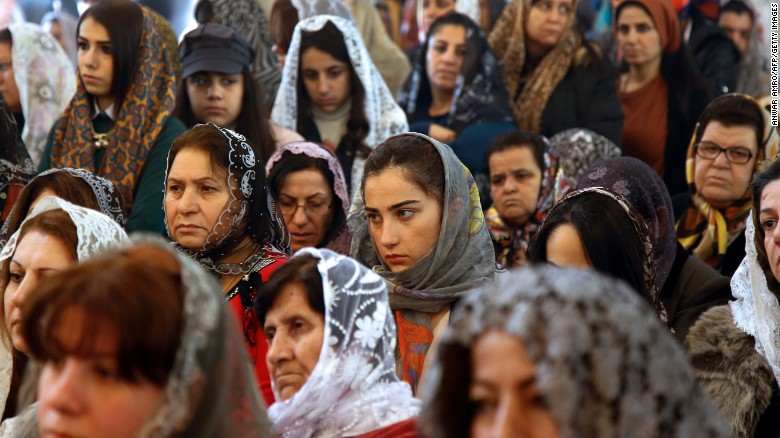 Assyrian Christians from Syria and Iraq, attend a Christmas mass at Saint Georges church in an eastern suburb of the Lebanese capital Beirut, on December 25, 2015. AFP PHOTO / ANWAR AMRO / AFP / ANWAR AMRO (Photo credit should read ANWAR AMRO/AFP/Getty Images)
