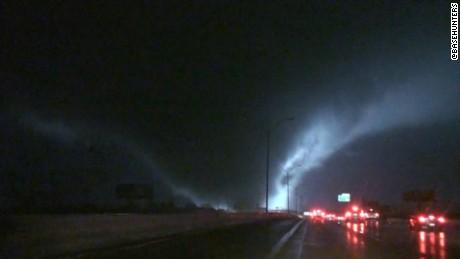 Massive tornado roars across highway_00000000