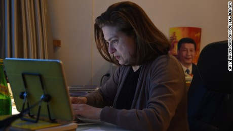 Ursula Gauthier works at her desk in her apartment in Beijing on December 26, 2015.